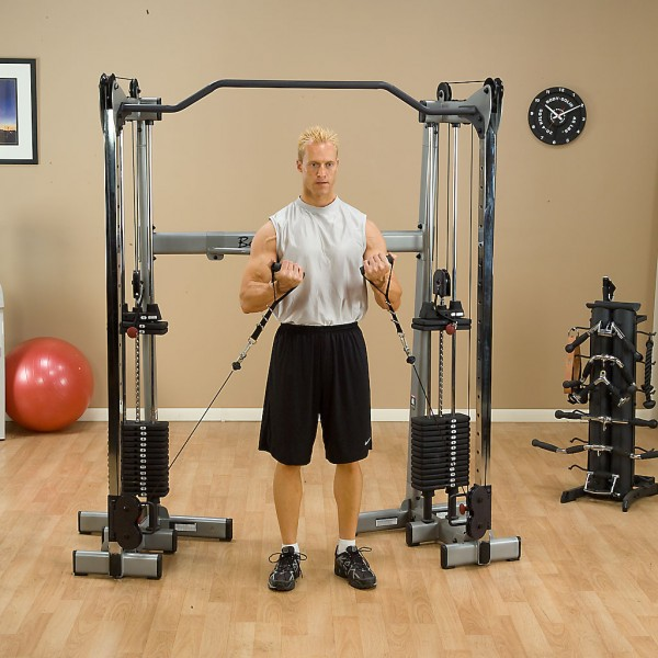 guy using body solid functional trainer gym pros